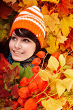 Girl in autumn  leaves with bunch. Royalty Free Stock Images
