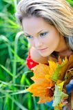 Girl with autumn leaves outdoor stock photos