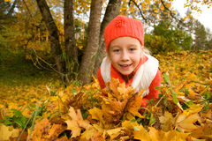 Girl with autumn leaves outdoors Royalty Free Stock Photos