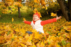 Girl with autumn leaves outdoors Royalty Free Stock Photography
