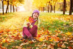 Girl in the autumn leaves in the Park in the fresh air. Royalty Free Stock Images