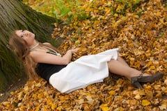 Girl on autumn leaves Stock Photo