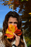 Girl and autumn leaves Royalty Free Stock Photography
