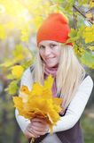 Girl with autumn leaves Royalty Free Stock Photos