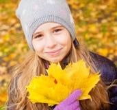 Girl at autumn Stock Photos