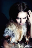 Girl with autumn makeup in furs Stock Photography