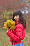 Girl with autumn maple leaves Royalty Free Stock Photography