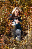 Girl in autumn nature Royalty Free Stock Photography