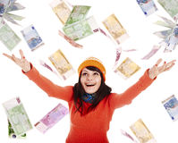 Girl in autumn orange hat with flying money euro royalty free stock photography