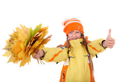 Girl in autumn orange hat holding leaves. Stock Photo