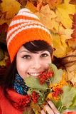 Girl in autumn orange hat on leaf group. stock image