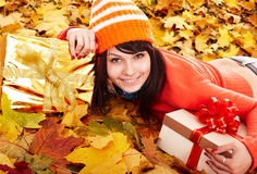 Girl in autumn orange hat on leaf group. Royalty Free Stock Photo