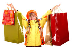 Girl in autumn orange hat with  shopping bag. Royalty Free Stock Photo
