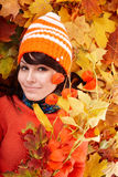 Girl in autumn orange leaves. Outdoor royalty free stock images