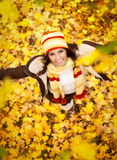Girl in autumn orange leaves, outdoor Royalty Free Stock Images