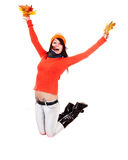 Girl in autumn orange sweater with leaf jump. Stock Photo