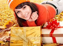 Girl in autumn outdoor holding gift box. Stock Images