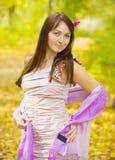 Girl in autumn park Stock Photos