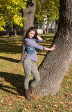 Girl in autumn park Stock Photography