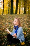 Girl in autumn park Royalty Free Stock Images