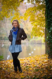 Girl in autumn park Royalty Free Stock Image