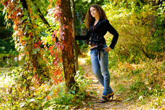Girl in autumn park. Near the pond Royalty Free Stock Photography