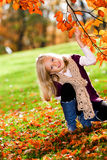 Girl in the autumn park Royalty Free Stock Photography