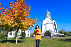 Girl in Autumn park and church Stock Images