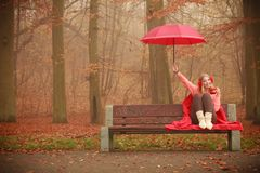 Girl in autumn park enjoying hot drink Royalty Free Stock Images
