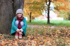 Girl in autumn park outdoor Stock Photos