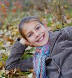 Girl in a autumn park Royalty Free Stock Photos