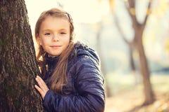 Girl autumn park Stock Photos