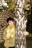 The girl in autumn park with an umbrella. Royalty Free Stock Photography