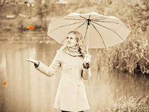 Girl in autumn rain Stock Photo