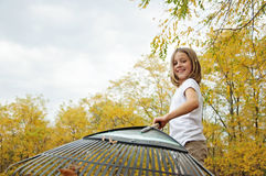 Girl in  Autumn raking leaves Stock Image