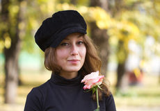 Girl autumn rose cap Stock Images