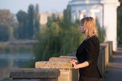 Girl on autumn street 5. City embankment. Stock Photo