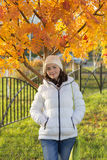 Girl on the autumn street Royalty Free Stock Images