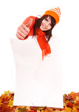 Girl in autumn  sweater holding banner. Stock Photo