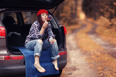 Girl at autumn trip by car Royalty Free Stock Images