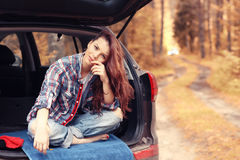 Girl at autumn trip by car Royalty Free Stock Photo