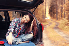 Girl at autumn trip by car Royalty Free Stock Photography
