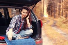 Girl at autumn trip by car Royalty Free Stock Photos