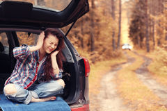 Girl at autumn trip by car Stock Image