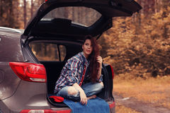 Girl at autumn trip by car Stock Photo