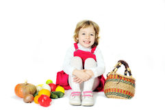 Girl with autumn vegetables Stock Photos
