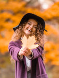 Girl on autumn walk Stock Images