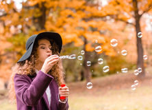 Girl on autumn walk Stock Photography