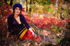 The girl in autumn wood Royalty Free Stock Photos