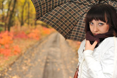 The girl in an autumn wood with a umbrella. Royalty Free Stock Photos